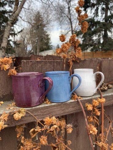 Blue, purple and white pottery mugs
