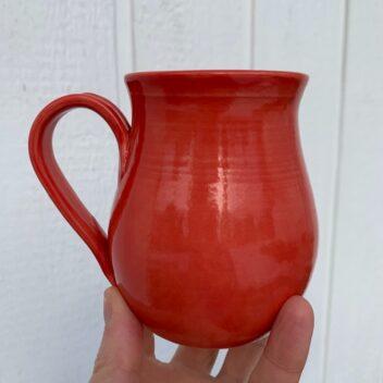Red pottery mug