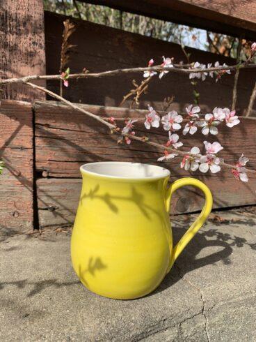 Yellow pottery mug